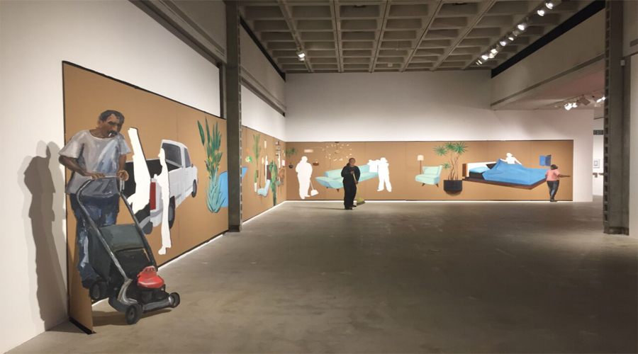 This installation by the artist Ramiro Gomez features a large and long panoramic painting on cardboard. The cardboard surface contains imagery depicting scenes of individuals involved in manual labor acts or environments. The individuals are seperated from the cardboard surface along the gallery wall and propped upright into the gallery space. The imagery present includes: a work truck, plants, general and bedroom furniture, and individuals involved in manual labor actions.