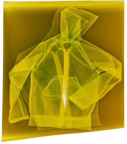 This artwork by Farrah Karapetian includes a bi-layering of a translucent item of apparel reminiscent of a common hoodie. The bi-layered hoodie lies flat against a similarly translucent background. Both the background and the bi-layered hoodie are rendered in a translucent yellow glowing hue.