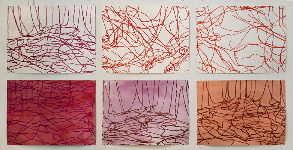 This artwork by Kristin Calabrese includes a series of six rectangular drawings mounted onto the gallery wall, side-by-side, in a grid-like display. The grid is made up of two rows and three columns. The surfaces of the artworks have been treated with red-pigmented linear gestures that render loosely and random. The three panels above are absent of background color in contrast to the three panels below. The primary hue rendered here is red and then altered in its tint, tone, shade, and opacity among the individual panels.