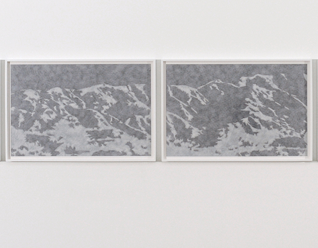 These prints by Joe Davidson is presented as a diptych of two large mountainous landscapes. Both images are mounted horizontally side-by-side onto a gallery wall of the exhibition. Each image, in a white frame, consists of a grey-scale depiction of a landscape. Darker shades are utilized in presenting deep angles, dimensionality, and absence of light while whites and lighter tints are utilized in further establishing spacial dimensionality, presence of a light source, and where it reaches the landscape, and the edges protruding forward of this rock-forms.