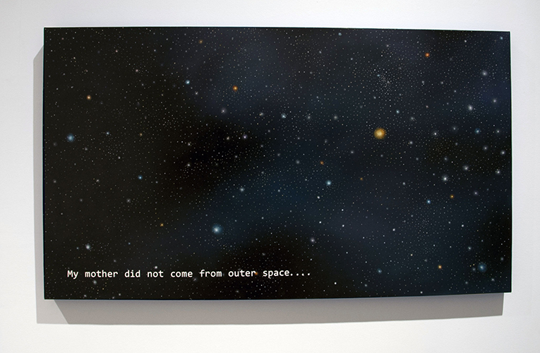 This painting by Nery Gabriel Lemus features an outer space landscape. The background treatment of the artwork consists of transitioning blacks and blues in a splotch-like manner. Throughout this background are countless circles rendered in bright and glowing colors. In the bottom left of the surface is the text: My mother did not come from outer space...