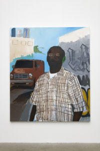 "In this painting by the artist Henry Taylor, a male person of color is standing in the foreground. His left ear is painted green, and he is wearing an off white checkered shirt. Over his left shoulder is a brown van parked on the street, while over his right shoulder is a wall with graffiti that says, ""L.A.""."