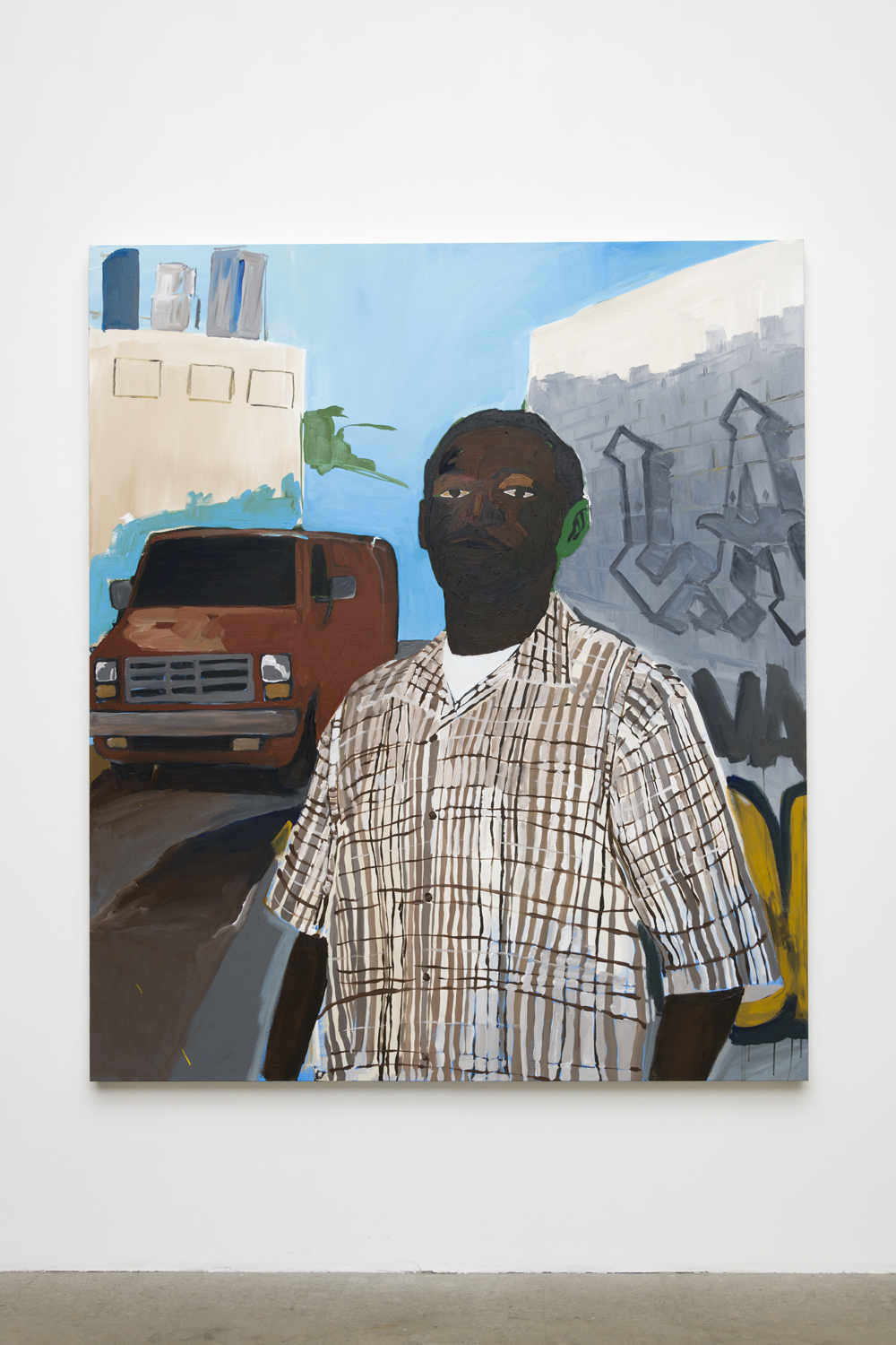 In this painting by the artist Henry Taylor, a male person of color is standing in the foreground. His left ear is painted green, and he is wearing an off white checkered shirt. Over his left shoulder is a brown van parked on the street, while over his right shoulder is a wall with graffiti that says,