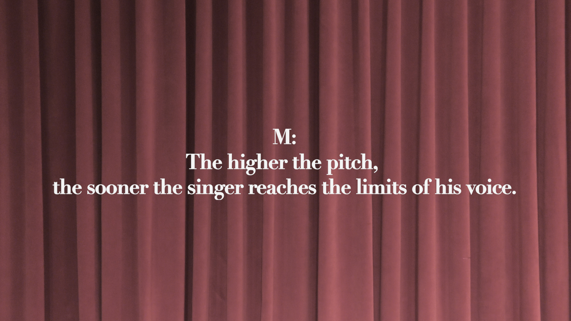 This image features a still of an artwork by YoungEun Kim. The still includes a dark burgundy, curtain-esque background with text in white saying M: The higher the pitch, the sooner the singer reaches the limits of his voice.