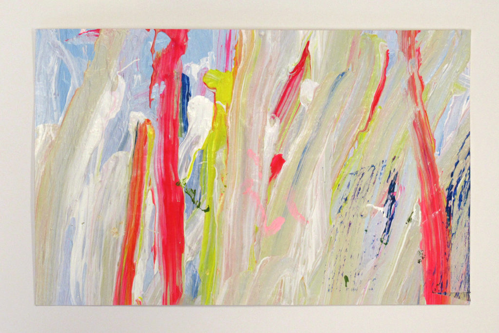 This is a color photograph of an abstract painting by Vanessa McConnell. The painting features layers of different colors, such as yellow, red, and blue, and most of the paint strokes go in a vertical direction.