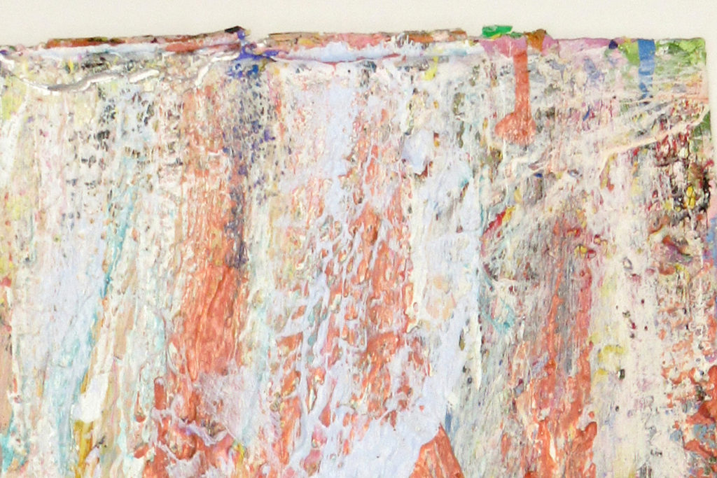 This is a color photograph of a detail of an abstract painting by Vanessa McConnell. The painting features thick layers of paint in various colors, such as blue, orange, white, yellow, and black.